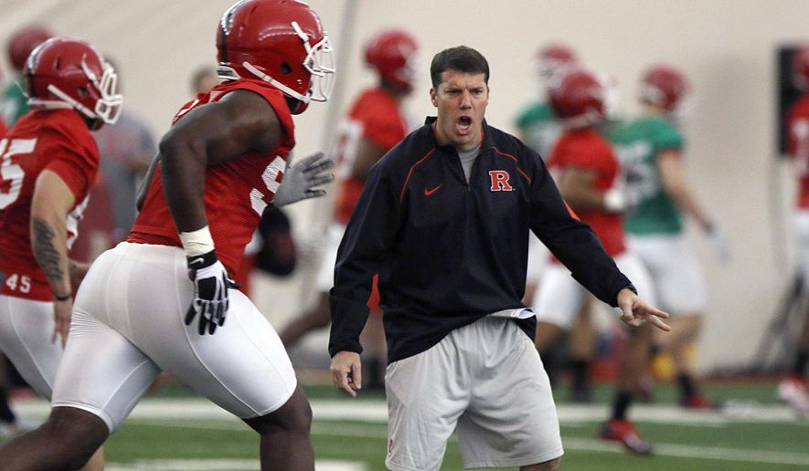 Rutgers NCAA college football coach Chris Ash talks to players during a spring practice Thursday, March 24, 2016, in Piscataway, N.J.   (Chris Pedota /The Record of Bergen County via AP) ONLINE OUT; MAGS OUT; TV OUT; INTERNET OUT;  NO ARCHIVING; MANDATORY CREDIT