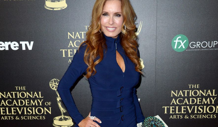 """FILE - In this June 22, 2014 file photo, actress Tracey E. Bregman, from """"The Young and the Restless,"""" arrives at the 41st annual Daytime Emmy Awards in Beverly Hills, Calif. Bregman was nominated for an Emmy award for outstanding lead actress in a drama series on Thursday, March 24, 2016, for her role on the daytime drama on CBS. CBS led with 77 nominations overall while its daytime drama """"The Young and the Restless"""" led with 27 nods. The 43rd Annual Daytime Emmy awards will be held on May 1. (Photo by Richard Shotwell/Invision/AP, File)"""