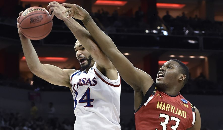 Kansas forward Perry Ellis (34) pulls down a rebound away from Maryland center Diamond Stone (33) during the first half of an NCAA college basketball game in the regional semifinals of the men's NCAA Tournament, in Louisville, Ky., Thursday, March 24, 2016. (AP Photo/John Flavell)