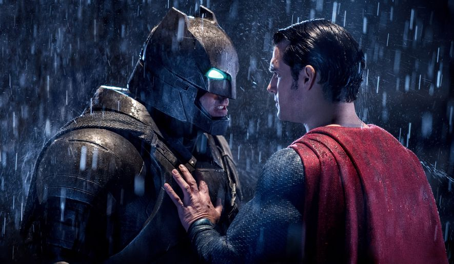 "This image released by Warner Bros. Pictures shows Ben Affleck, left, and Henry Cavill in a scene from, ""Batman v Superman: Dawn of Justice.""  (Clay Enos/Warner Bros. Pictures via AP)"