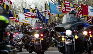 Maryland police escort the hearse containing the casket of Police Officer First Class Jacai Colson upon his arrival for funeral services at First Baptist Church of Glenarden, Friday, March 25, 2016, in Upper Marlboro, Md. Jacai Colson, a four-year veteran of the force and a undercover narcotics officer was mortally wounded by his own colleagues as he responded to an attack on his police station by a gunman with a death wish. ( AP Photo/Jose Luis Magana)