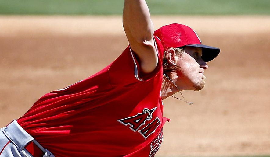 Los Angels Angels pitcher Jered Weaver throws against the Oakland A's during the second inning of a spring training baseball game, Friday, March 25, 2016, in Mesa, Ariz. (AP Photo/Matt York)