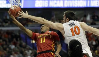 Iowa State's Monte Morris (11) drives to the basket against Virginia's Mike Tobey (10) during the first half of a college basketball game in the regional semifinals of the NCAA Tournament, Friday, March 25, 2016, in Chicago. (AP Photo/Nam Y. Huh)