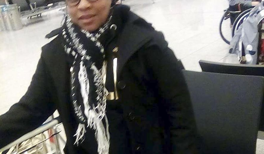 In this photo made Tuesday, March 22, 2016, and provided by her family, Elita Borbor Weah stands in the Brussels Airport in Brussels, Belgium, shortly before bombs went off nearby. Weah, who was on her way to Rhode Island for her stepfather's funeral, texted the photo of herself to family members just before she died in the attack. (Courtesy of the Weah Family via AP)