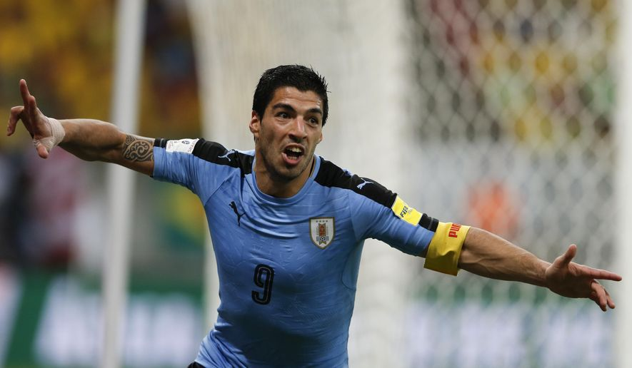 Uruguay's Luis Suarez celebrates after scoring against Brazil during a 2018 World Cup qualifying soccer match at the Pernambuco Arena, in Recife, Brazil, Friday, March 25, 2016. (AP Photo/Leo Correa)