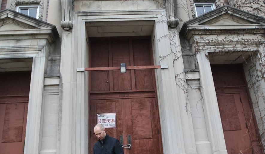 Eric Tysland, Burlington's community development and park director, exits Apollo School, Burlington's former high school, Wednesday, March 23, 2016 in Burlington, Iowa. Developers presented ideas to the Burlington City Council about possible renovations to the building with an additional presentation slotted for April. (Ben Roberts /The Hawk Eye via AP) MANDATORY CREDIT