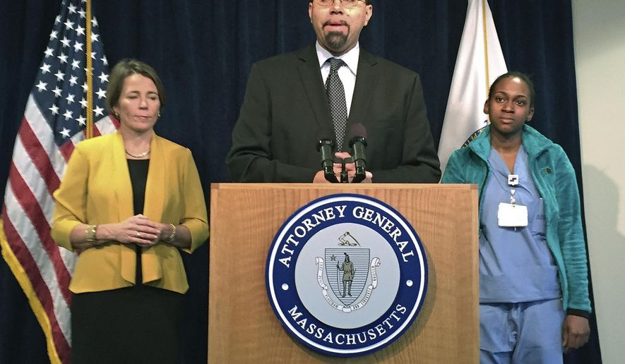 U.S. Education Secretary John B. King Jr., center, speaks Friday, March 25, 2016, in Boston, announcing that more students who were defrauded by the now-defunct Corinthian Colleges can have their loans forgiven. Corinthian, a former chain of for-profit colleges, sold or closed its schools in 2015 amid fraud allegations. With King are Massachusetts Attorney General Maura Healey, left, who helped uncover evidence of two schools that misrepresented job placement rates, and Shalaan Williams, right, a student who attended one of the schools. (AP Photo/Bob Salsberg)