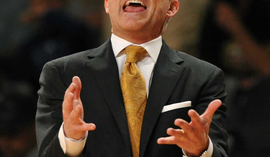 FILE - In this March 8, 2014, file photo, Georgia Tech head coach Brian Gregory disputes a foul call during the first half of an NCAA college basketball game against Virginia Tech in Atlanta. Georgia Tech has fired Gregory. The moved was announced Friday, March 25, 2016, by athletic director Mike Bobinski, two days after the Yellow Jackets season ended in the NIT. (AP Photo/David Tulis, File)