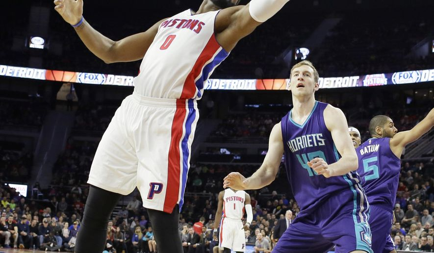 Detroit Pistons center Andre Drummond (0) reaches for an inbound pass in front of Charlotte Hornets center Cody Zeller (40) during the first half of an NBA basketball game, Friday, March 25, 2016, in Auburn Hills, Mich. (AP Photo/Carlos Osorio)