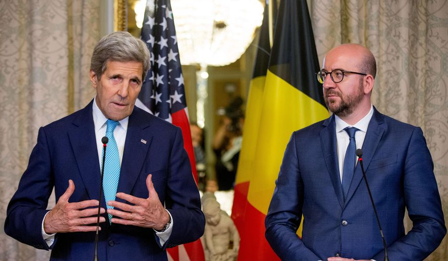 Secretary of State John Kerry, left, and Belgian Prime Minister Charles Michel give a joint statement at the Belgian Prime Minister's Residence in Brussels, Belgium, Friday, March 25, 2016. Kerry is in Brussels to pay respect to victims of terrorist attacks that left tens of people dead . (AP Photo/Andrew Harnik, Pool)