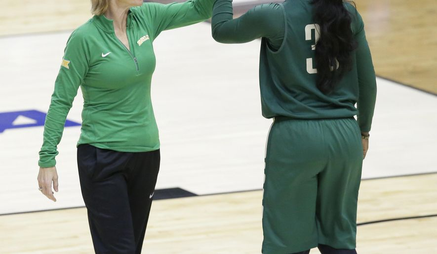 Baylor head coach Kim Mulkey, left, gives a high-five to guard Alexis Jones (30) during college basketball practice in the regional semifinals of the women's NCAA Tournament Friday, March 25, 2016, in Dallas, Texas. Baylor takes on Florida State on Saturday.  (AP Photo/LM Otero)