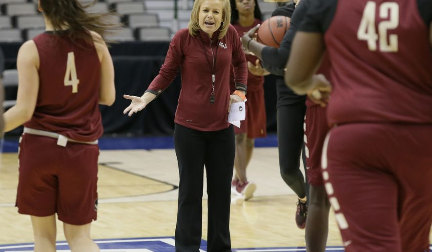 Florida State head coach Sue Semrau talks to her players during college basketball practice in the regional semifinals of the women's NCAA Tournament Friday, March 25, 2016, in Dallas, Texas. Florida State takes on Baylor on Saturday. (AP Photo/LM Otero)
