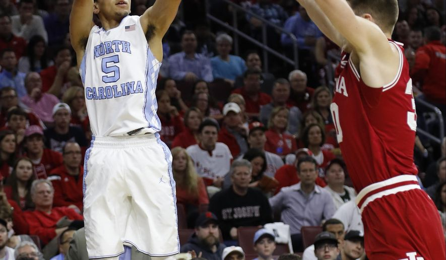 North Carolina's Marcus Paige shoots against Indiana's Collin Hartman during the first half of an NCAA college basketball game in the regional semifinals of the men's NCAA Tournament, Friday, March 25, 2016, in Philadelphia. (AP Photo/Matt Rourke)