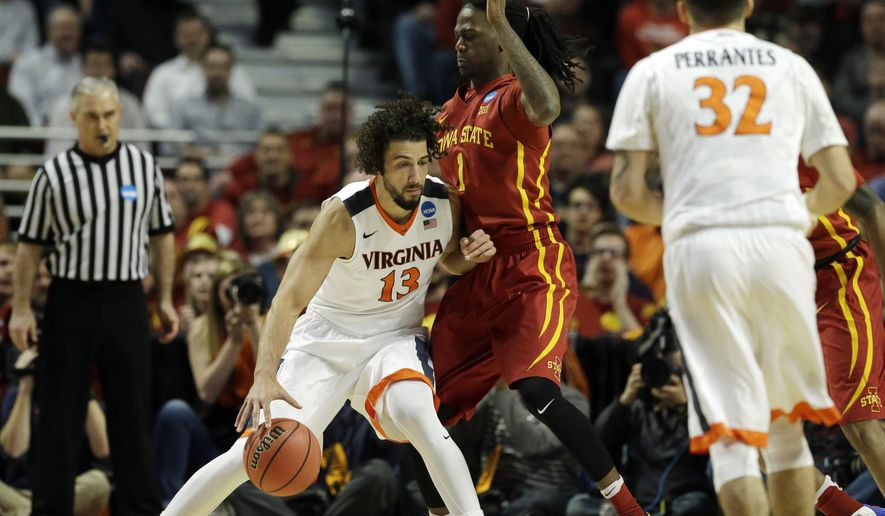 Virginia's Anthony Gill (13) drives against Iowa State's Jameel McKay (1) during the first half of a college basketball game in the regional semifinals of the NCAA Tournament, Friday, March 25, 2016, in Chicago. (AP Photo/Nam Y. Huh)