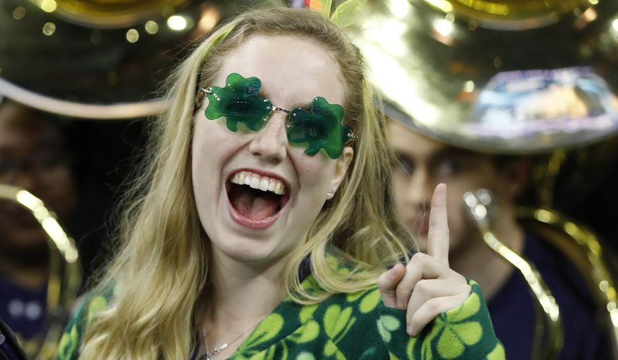 A Notre Dame fan poses before an NCAA college basketball game between Notre Dame and Wisconsin in the regional semifinals of the men's NCAA Tournament, Friday, March 25, 2016, in Philadelphia. (AP Photo/Chris Szagola)