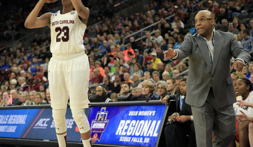 South Carolina's Tina Roy (23) shoots as Syracuse coach Quentin Hillsman, right, calls instructions, during a women's college basketball regional semifinal game in the NCAA Tournament in Sioux Falls, S.D., Friday, March 25, 2016. (AP Photo/Nati Harnik)