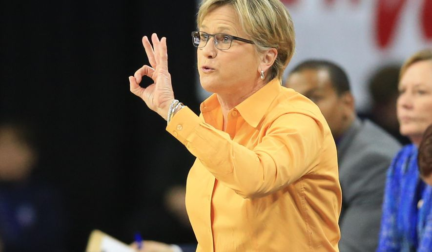 Tennessee coach Holly Warlick calls a play during a women's college basketball regional semifinal against Ohio State in the NCAA Tournament in Sioux Falls, S.D., Friday, March 25, 2016. (AP Photo/Nati Harnik)