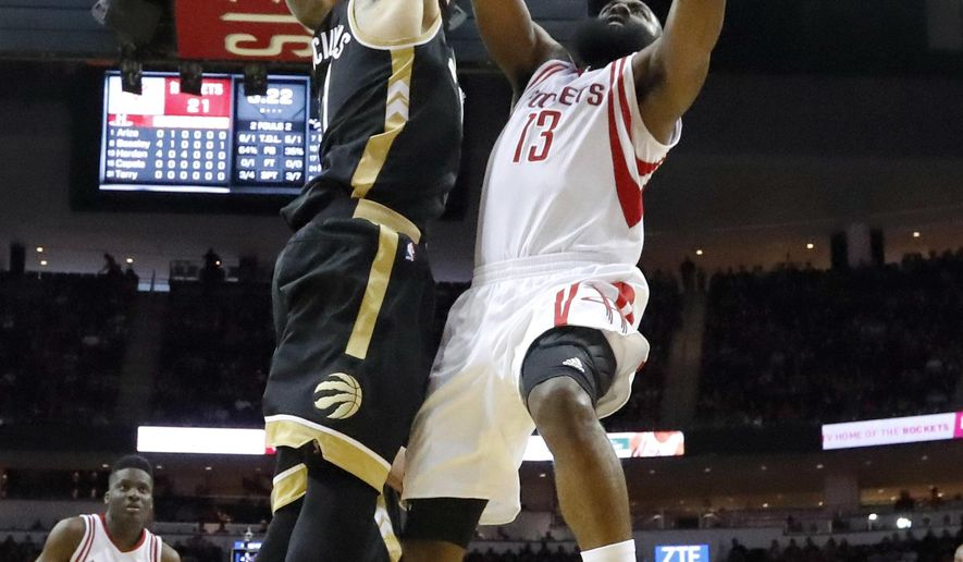 Houston Rockets' James Harden (13) goes up for a shot as Toronto Raptors' Jonas Valanciunas defends during the first quarter of an NBA basketball game Friday, March 25, 2016, in Houston. (AP Photo/David J. Phillip)