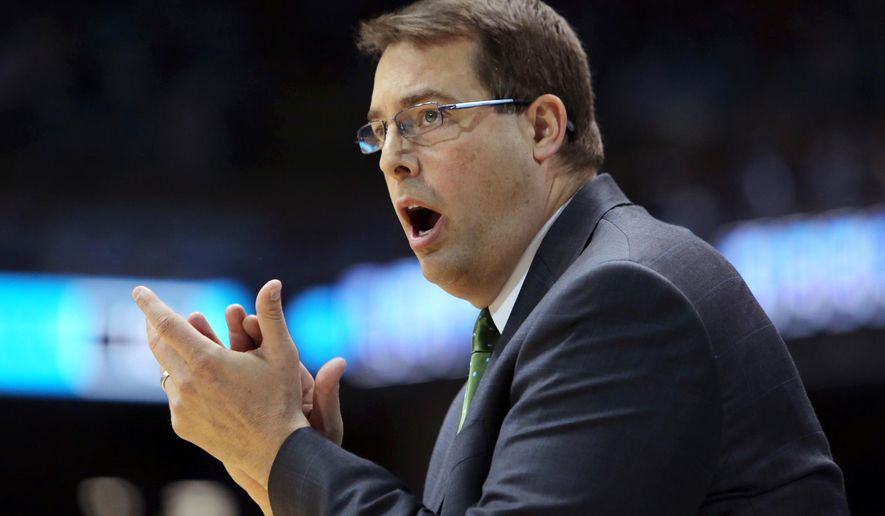 FILE - In this Dec. 1, 2012 file photo, UAB head coach Jerod Haase encourages his players during the first half of an NCAA college basketball game against North Carolina in Chapel Hill, N.C. Stanford hired Haase as its new basketball coach on Friday, March 25, 2016, a week and a half after firing eighth-year coach Johnny Dawkins. (AP Photo/Ted Richardson, File)