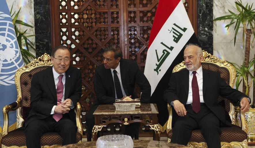 Iraqi Foreign Minister Ibrahim al-Jaafari, right, meets United Nations Secretary-General Ban Ki-moon, left, in Baghdad, Iraq, Saturday, March 26, 2016. (AP Photo/Hadi Mizban)