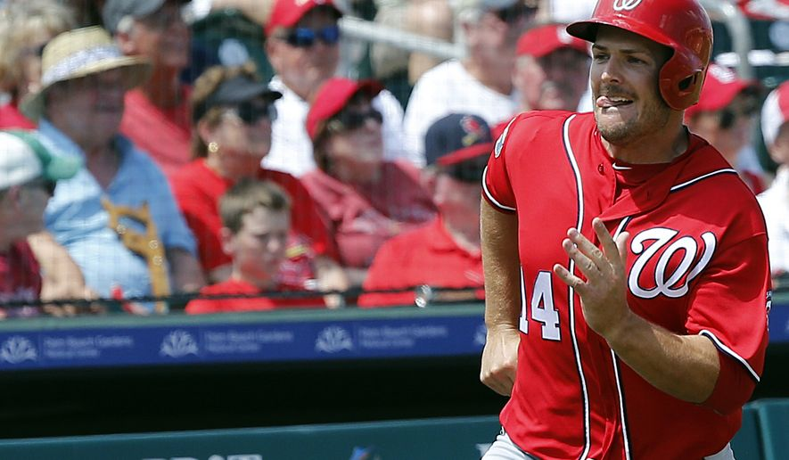 Washington Nationals' baserunner Chris Heisey rounds third scoring during the fourth inning of an exhibition spring training baseball game against the St. Louis Cardinals, Saturday, March 26, 2016, in Jupiter, Fla. (AP Photo/Brynn Anderson)