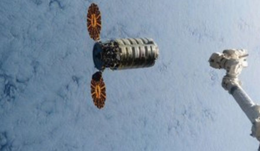 This still image taken from NASA TV shows a commercial cargo ship named Cygnus about to connect to the International Space Station on Saturday, March 26, 2016. It's the first of three shipments coming up in quick succession. A Russian cargo ship will lift off in a few days, followed by a SpaceX supply run on April 8. NASA has turned to private industry to keep the space station stocked. (NASA via AP)