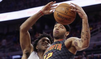 Atlanta Hawks forward Mike Scott (32) grabs a rebound next to Detroit Pistons forward Stanley Johnson during the first half of an NBA basketball game, Saturday, March 26, 2016, in Auburn Hills, Mich. (AP Photo/Carlos Osorio) **FILE**