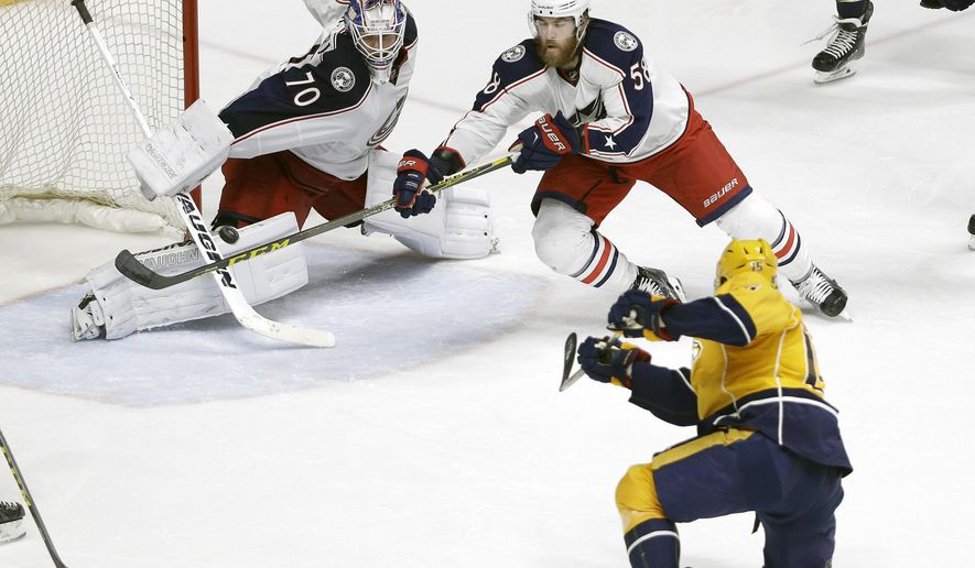 Nashville Predators center Craig Smith (15) scores a goal against Columbus Blue Jackets goalie Joonas Korpisalo (70), of Finland, and defenseman David Savard (58) in the second period of an NHL hockey game Saturday, March 26, 2016, in Nashville, Tenn. (AP Photo/Mark Humphrey)