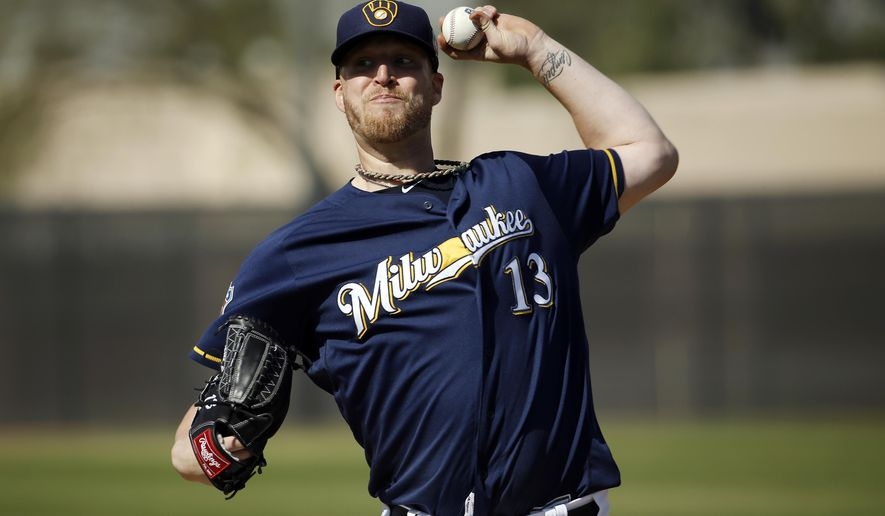 FILE - In this Tuesday, March 1, 2016 file photo, Milwaukee Brewers' Will Smith throws during a spring training baseball workout in Phoenix. The Milwaukee Brewers will start the season without reliever Will Smith, who tore a ligament in his right knee while taking his spikes off after a game, Saturday, March 26, 2016.  (AP Photo/Morry Gash, File)