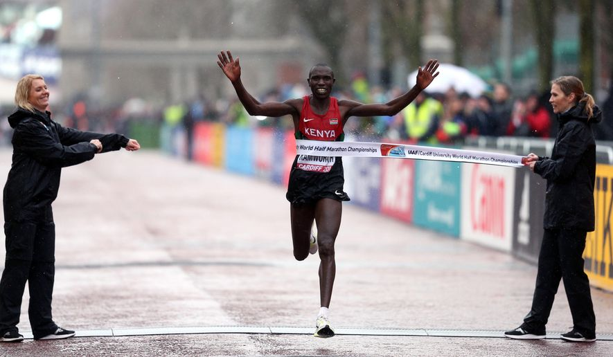 Kenya's Geoffrey Kipsang Kamworor wins the Men's Elite 2016 IAAF World Half Marathon Championships in Cardiff, Wales, Saturday March 26, 2016. (David Davies / PA via AP) UNITED KINGDOM OUT - NO SALES - NO ARCHIVES