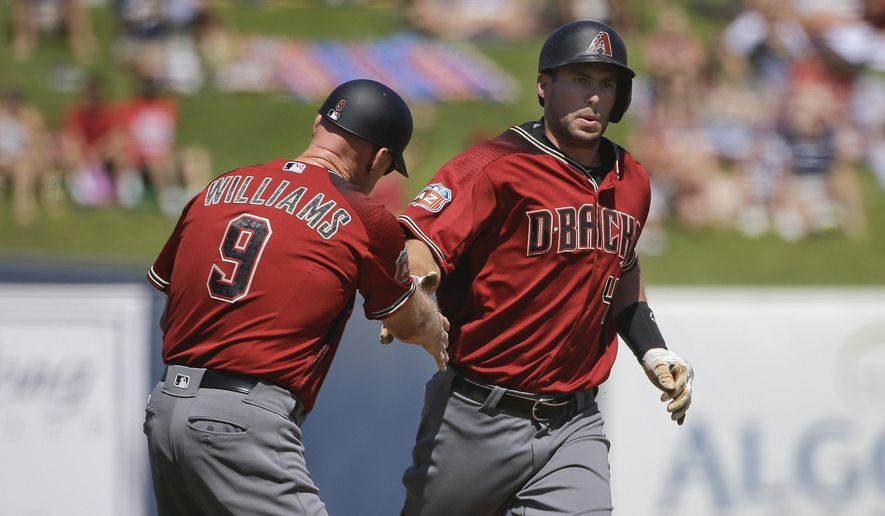 Arizona Diamondbacks' Paul Goldschmidt, right, celebrates his home run with third base coach Matt Williams during the first inning of a spring training baseball game against the Milwaukee Brewers, Saturday, March 26, 2016, in Phoenix. (AP Photo/Jae C. Hong)