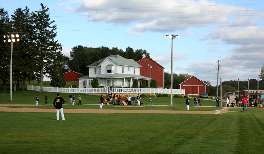 In this file photo from Oct. 2, 2014, teams play at the Field of Dreams during a fall tournament in Dyersville, Iowa. Nearly two years after its announced opening date, All-Star Ballpark Heaven has yet to materialize. The Telegraph Herald reports in March 2016 that plans for the 24-field youth baseball and softball complex are underway at the Field of Dreams movie site, according to Denise Stillman, president and CEO of field ownership group Go the Distance Baseball LLC. (Dave Kettering/Telegraph Herald via AP) MANDATORY CREDIT
