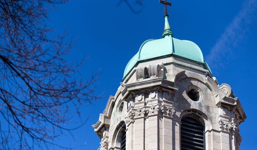 This March 5, 2016 photo shows the tower at St. Frances Cabrini Catholic Church in Omaha, Neb. Repairs will let St. Frances Cabrini's 150-year-old bells ring once again after more than three decades. (Megan Farmer/Omaha World-Herald via AP)  MAGS OUT; ALL NEBRASKA LOCAL BROADCAST TELEVISION OUT; MANDATORY CREDIT