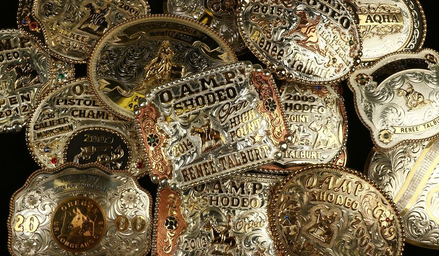 ADVANCE FOR USE SATURDAY, MARCH 26 - In this photo taken March 8, 2016, a collection of award buckles earned by Renee Talburt of Roseburg, Ore., are displayed. (Michael Sullivan/The News-Review via AP) MANDATORY CREDIT
