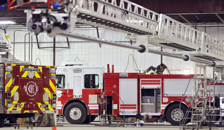 ADVANCE FOR THE WEEKEND OF MARCH 26-27 AND THEREAFTER - In a Feb. 23, 2016 photo, Nick Harding works atop a 105-foot ladder truck destined for Omaha at the Smeal Fire Apparatus company in Snyder, Neb. The Smeal Fire Apparatus Co. plant sits on the western edge of Snyder, a town of of 298, not far from Fremont, and it employs more people than that in jobs ranging from the front offices to the production lines working on 45 to 60 firetrucks at a time.  (Eric Gregory/The Journal-Star via AP) LOCAL TELEVISION OUT; KOLN-TV OUT; KGIN-TV OUT; KLKN-TV OUT; MANDATORY CREDIT