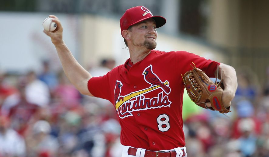 St. Louis Cardinals' starting pitcher Mike Leake throws during the first inning of an exhibition spring training baseball game against the Washington Nationals, Saturday, March 26, 2016, in Jupiter, Fla. (AP Photo/Brynn Anderson)