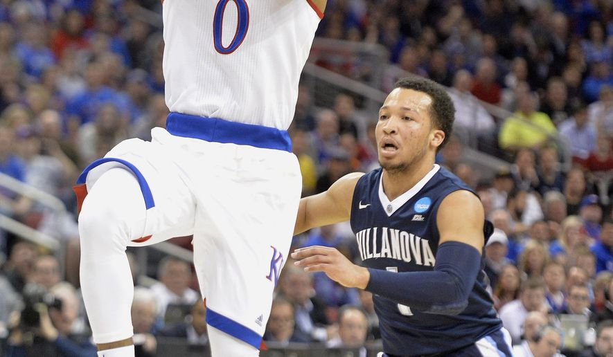 Kansas guard Frank Mason III (0) shoots against Villanova guard Jalen Brunson (1) during the first half of a regional final men's college basketball game in the NCAA Tournament, Saturday, March 26, 2016, in Louisville, Ky. (AP Photo/Timothy D. Easley)