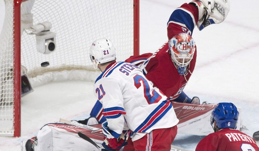 Montreal Canadiens goaltender Mike Condon is scored on by New York Rangers' Derek Stepan during the second period of an NHL hockey game, Saturday, March 26, 2016 in Montreal.  (Graham Hughes/The Canadian Press via AP) MANDATORY CREDIT