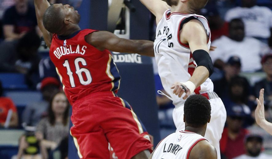 New Orleans Pelicans guard Toney Douglas (16) goes to the basket against Toronto Raptors center Jonas Valanciunas (17) in the first half of an NBA basketball game in New Orleans, Saturday, March 26, 2016. (AP Photo/Gerald Herbert)