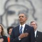 "Backdropped by a monument depicting Cuba's revolutionary hero Ernesto ""Che"" Guevara, U.S. President Barack Obama listens to the U.S. national anthem during a ceremony at the Jose Marti Monument in Havana, Cuba, Monday, March 21, 2016. (AP Photo/Dennis Rivera)"