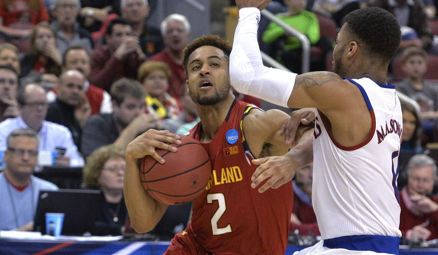 Maryland guard Melo Trimble (2) attempts to get through the defense of Kansas guard Frank Mason III (0) during the second half of an NCAA college basketball game in the regional semifinals of the men's NCAA Tournament, in Louisville, Ky., Thursday, March 24, 2016. Kansas won 79-63. (AP Photo/Timothy D. Easley)