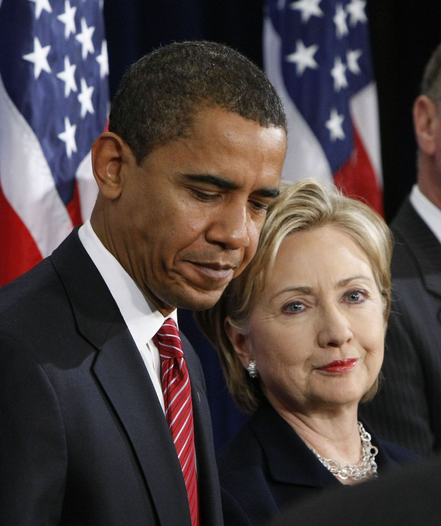 President-elect Barack Obama, left, stands with Secretary of State-designate Sen. Hillary Rodham Clinton, D-N.Y., right, at a news conference in Chicago, Dec. 1, 2008. (AP Photo/Pablo Martinez Monsivais) **FILE**
