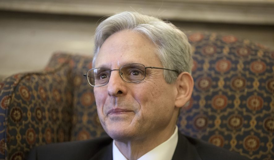 Judge Merrick Garland, President Barack Obama's choice to replace the late Justice Antonin Scalia on the Supreme Court, meets with Sen. Patrick Leahy, D-Vt., ranking member on the Senate Judiciary Committee, on Capitol Hill in Washington, in this March 17, 2016, file photo. (AP Photo/J. Scott Applewhite, File)