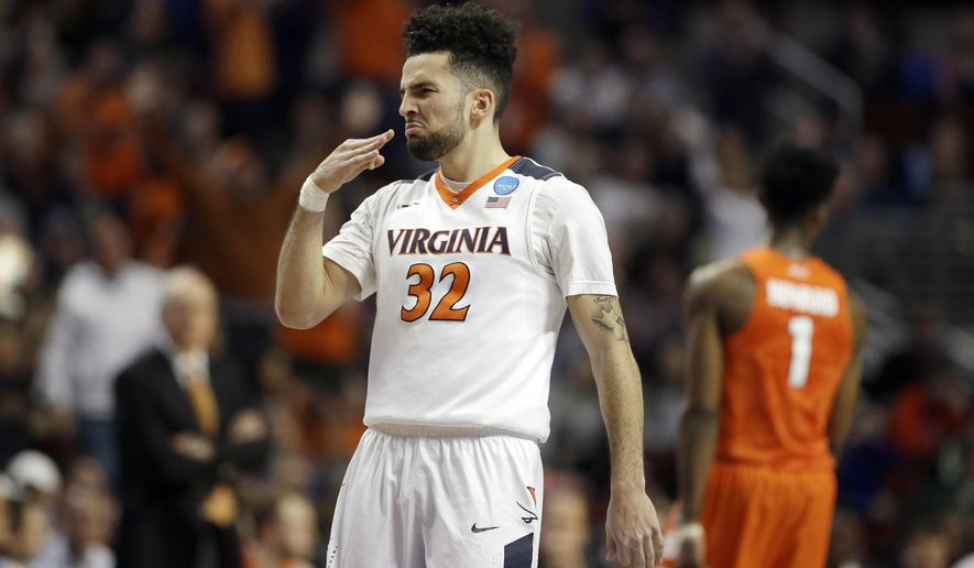 Virginia's London Perrantes (32) reacts after his three point basket during the first half of a college basketball game against Syracuse in the regional finals of the NCAA Tournament, Sunday, March 27, 2016, in Chicago. (AP Photo/Nam Y. Huh)