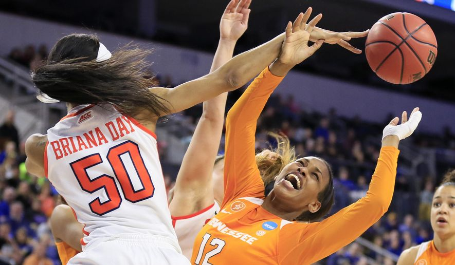 Tennessee forward Bashaara Graves (12) is fouled by Syracuse center Briana Day during the second half of a regional final women's college basketball game in the NCAA Tournament, Sunday, March 27, 2016, in Sioux Falls, S.D. Syracuse won 89-67. (AP Photo/Charlie Neibergall)