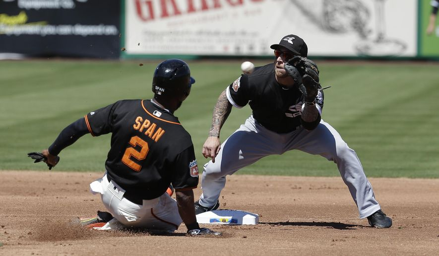 San Francisco Giants' Denard Span (2) steals second base against Chicago White Sox's Brett Lawrie, right, in the first inning of a spring training baseball game Sunday, March 27, 2016, in Scottsdale, Ariz. (AP Photo/Darron Cummings)