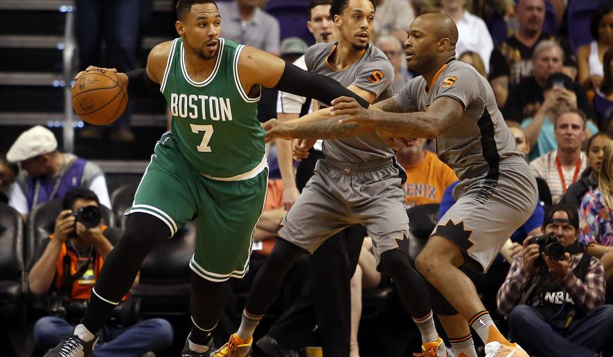 Boston Celtics center Jared Sullinger (7) drives on Phoenix Suns forward P.J. Tucker (17) in the first quarter during an NBA basketball game, Saturday, March 26, 2016, in Phoenix. (AP Photo/Rick Scuteri)