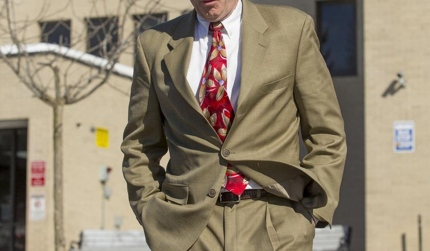 FILE - In this Feb. 5, 2015, file photo, Calvin Harris walks out of the Schoharie County Courthouse after the Tioga County district attorney made his opening statement in his third trial in Schoharie, N.Y. For the fourth time since Michele Harris disappeared in 2001, her estranged husband Harris will go on trial for murder in upstate New York. Jury selection on the latest trial starts Monday, March 28, 2016. (Simon Wheeler/The Journal via AP, File)  NO SALES; MANDATORY