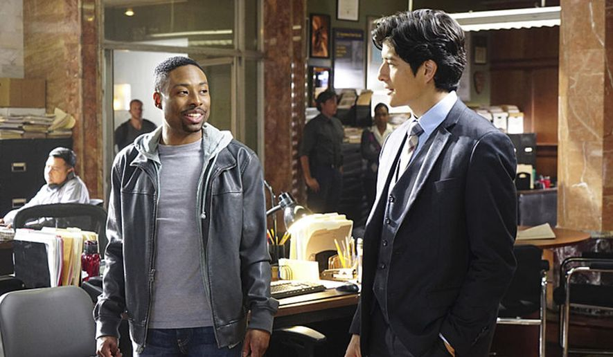 "Justin Hires (left) and Jon Foo in a scene from ""Rush Hour.""  (tvguide.com)"