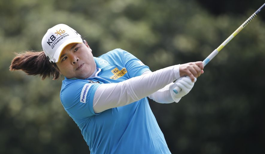 Inbee Park, from South Korea, follows through with her tee shot on the second hole during the final round of the Kia Classic women's golf tournament Sunday, March 27, 2016, in Carlsbad, Calif. (AP Photo/Lenny Ignelzi)